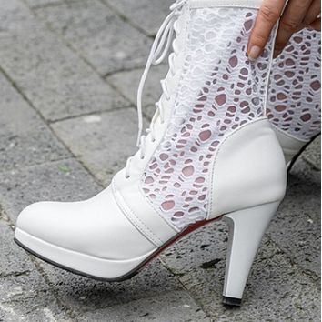 The new cross strap thick heel waterproof platform high heel leather boots shoes