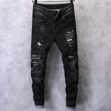 2018 new men's casual ripped holes jeans letters printing cotton pants male skinny zipper black stretch denim trousers