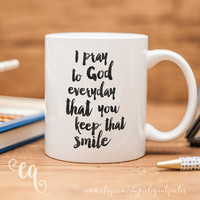 "Justin Bieber mug with quote from the song ""Next To You"" - ""I pray to god everyday that you keep that smile""."