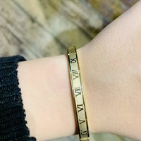 Stainless Steel Bracelet with Beautiful Roman Numeral Accents.