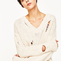 RIPPED SWEATER
