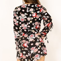 Summer Getaway playsuit in black floral Produced By SHOWPO