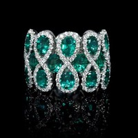 .72ct Diamond and Emerald 18k White Gold Ring