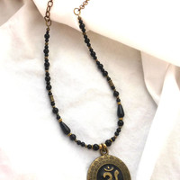 Onyx gemstone, bronze metal, Ohm pendant necklace.