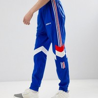 adidas Originals Vintage Tapered Joggers In Blue CE4854 at asos.com