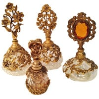 Collection of Four French Antique Perfume Bottles in Gilded Brass & Cut Crystal