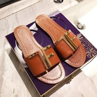 TOM FORD sells fashionable ladies' brown slippers with gold buttons