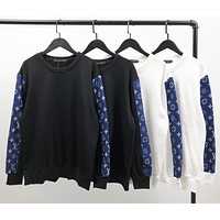 Louis Vuitton LV new coat top stitching blue sleeves black and white two-color cotton round neck sweater