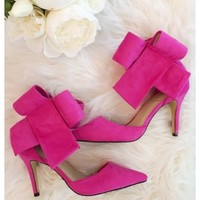 Bradshaw bow heels - Hot pink bow high heels with above the ankle closure.
