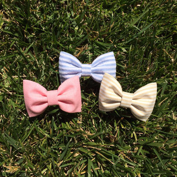 Pale blue stripe, tan stripe, and pink chambray hair bows from Seaside Sparrow.  Seaside Sparrow bows make the perfect birthday gift.