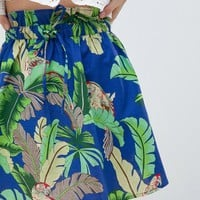 ASOS DESIGN mini skater skirt with tie waist in parrot print at asos.com