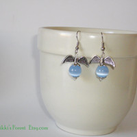 Valentine's Day. Pendant earrings, with metal wings and light blue glass pearls.