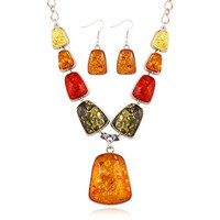 A Suit of  Geometric Shape Encrusted Faux Amber Necklace and Earrings