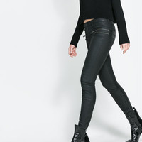 COATED TROUSERS WITH ZIPS