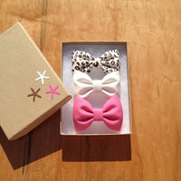 Cheetah, bubblegum pink, and winter white hair bows from seaside sparrow. The perfect gift.