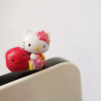 Cute and Charm Hello Kitty in Super Cute Dress Hugging a smiling stone IPhone & ear phone dust plug - Cellphone Accessories