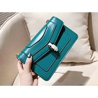 Bvlgari hot seller of shopping lady's one-shoulder bag in plain color with snake pattern Lake blue