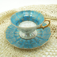 Royal Sealy footed teacup tea cup saucer in teal and gold trim and gold handle - Made in Japan