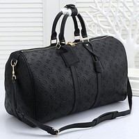 LV Louis Vuitton black embossed letters men and women large capacity hand luggage bag