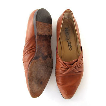 80s brown leather slip ons. knot detailed sandals.