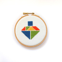 Spinning top cross stitch hoop art, nursery decor wall art, kids room decor, tangram shape