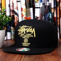 The World Tour Maroon Snapback Hat by Stussy Black golden