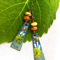 Glass and metal wire wrapped charm enameled earrings.