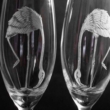Hand engraved Flamingoes on Flutes