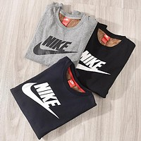 NIKE New fashion letter hook print couple keep warm long sleeve sweater
