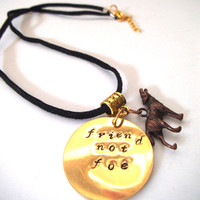 """Metal Stamped """"Friend Not Foe"""" Brass Round Pendant with Copper Wolf, Animal Rights Activism Education"""