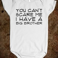 Supermarket: You Can't Scare Me I Have A Big Brother Baby Onesuit from Glamfoxx Shirts