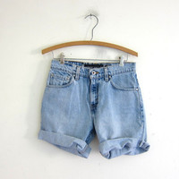 vintage light wash levis shorts / faded cut off jean shorts / Silver Tab fold over shorts