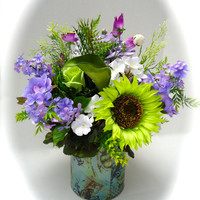 Silk Floral Spring Centerpiece in Decorative Tin with Purple and Green Flowers