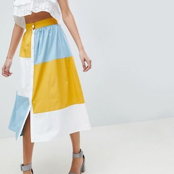ASOS DESIGN color block midi skirt with button front at asos.com