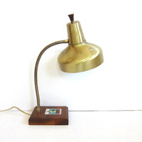Vintage gold metal gooseneck desk lamp with star cutouts and wooden base