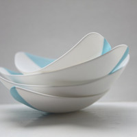 Stoneware fine bone china bowl with a touch of blue resembles a small boat.
