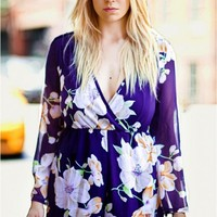 Purple floral playsuit with bell sleeves