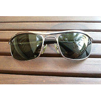 Ray Ban Olympian RB3119 004 sunglasses gunmetal frame green lenses