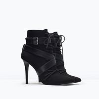 Lace-up high heeled bootie