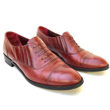 Vintage 1980s women's 'Torretti' rich oxblood leather slip on shoes with elastic sides and detailing