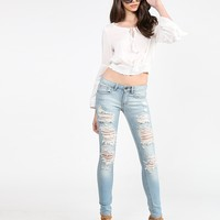 Heavily Destroyed Light Blue Denim Jeans