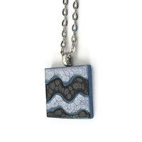 Abstract Waves Pendant Necklace, hand painted wooden tile pendant with metallic black, silver and blue on a blue background