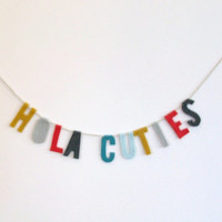 Hola Cuties felt party nook banner in yellow, greys, blues and red