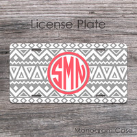 Gray Aztec license plate with coral monogram