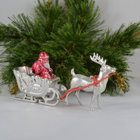 Vintage Plastic Santa And Sleigh With Metallic Finish