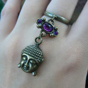 brass buddha ring with purple colored cabochon