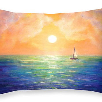 """Custom made decorative rectangular 20""""x14""""  throw pillow. Sailing boat artwork on pillow, seascape sunset colorful sky and clouds."""