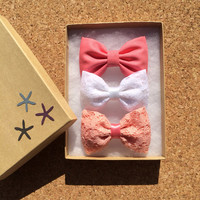 Beautiful vintage coral lace, white lace, and coral hair bows from Seaside Sparrow. Our vintage coral is limited.