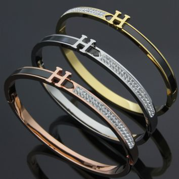 Hermes A black steel bracelet with a mudstone on the half of the letter H